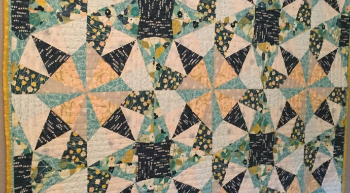Sea Glass Kalidescope Quilt using fabric for sale at Canadian online fabric shop Woven Modern Fabric Gallery