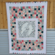 Baby quilt made with fabric from Canadian online fabric store Woven Modern Fabric Gallery